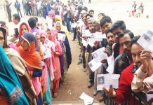 page3news-Voters queued up outside a polling booth